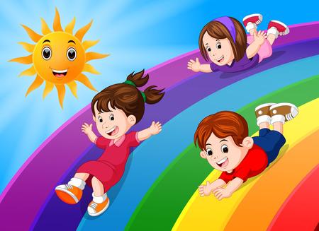 kids sliding on rainbow in sky Stock Photo