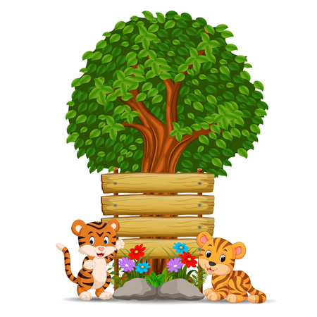 Two tiger in front of an empty wooden signboard