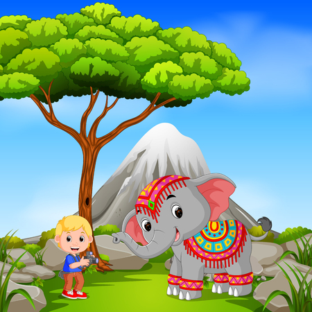 Elephant and photographer posing with mountain scene