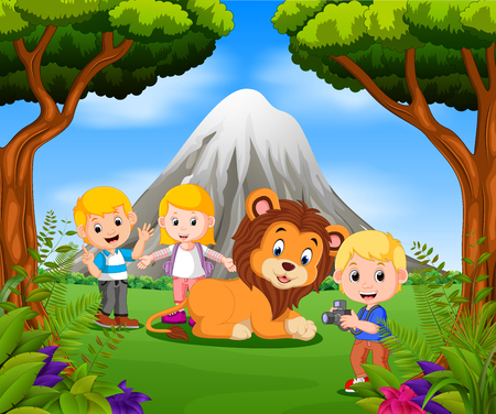 Young girl and boy posing with lion