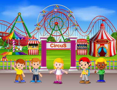 Childrens having fun in amusement park at daytime