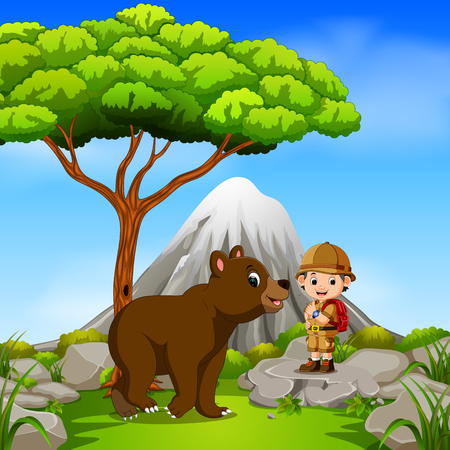 adventurer and bear posing with mountain scene Stock Photo