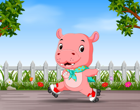 funny hippo playing roller skate in the road 写真素材
