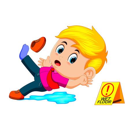 jongen uitglijden op natte vloer Stockfoto