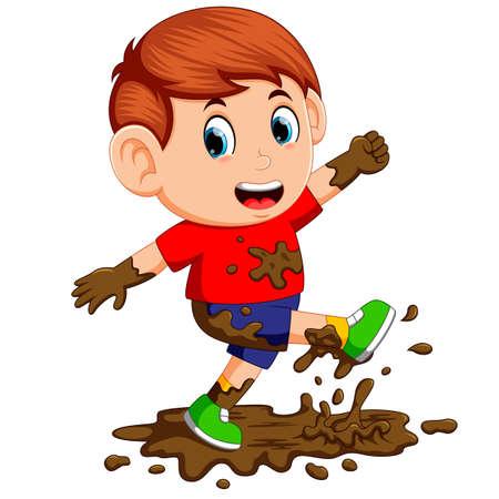 Little boy enjoy playing in the mud