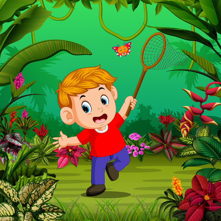 the boy tries to catch a butterfly in the forest Vectores