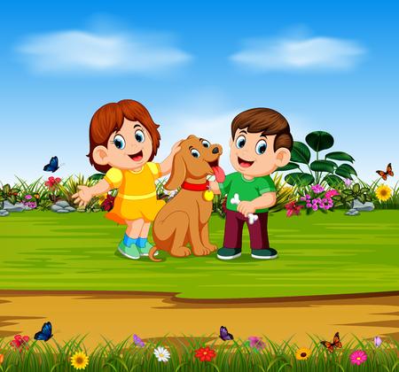 el niño y la niña están sosteniendo a su perro