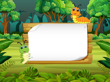 the wooden board blank space with cute caterpillar with forest background