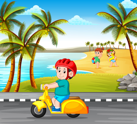 the boy driving the motorcycle on the road with the beach background