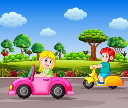 the children drive the transportation on the street with the garden background