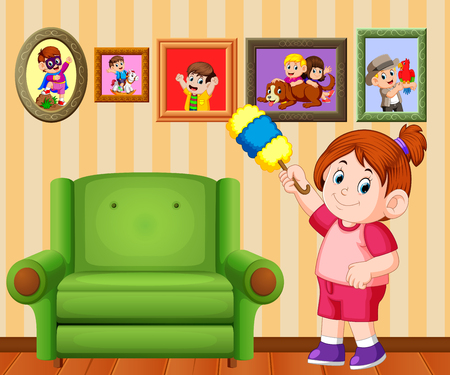 the beautiful girl clean the frame photo with the duster in her house Standard-Bild