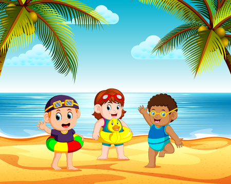 the children playing in the beach and using the tire in the bright day Stock Photo