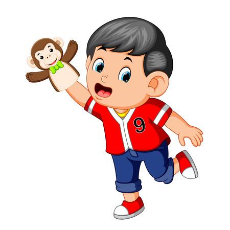 the boy was using monkey puppet Reklamní fotografie