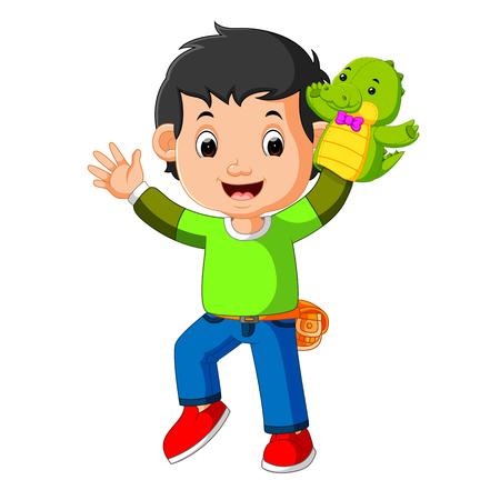 the happy boy was using crocodile puppet Reklamní fotografie