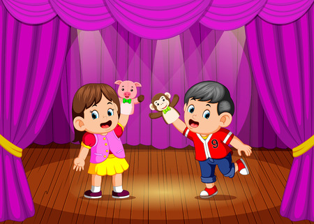 the children playing puppet in the stage