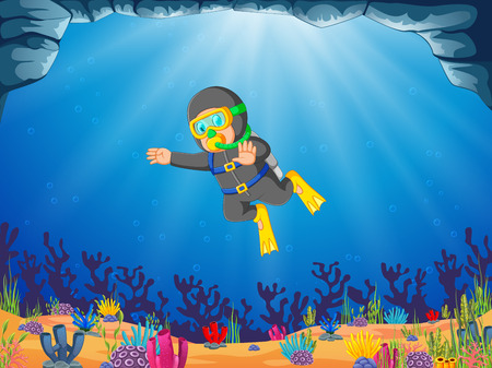 a man is diving under the blue ocean background using the oxygen tube Banque d'images