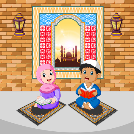 the two children are reading and praying with the happy face on the ramadan Stock Photo