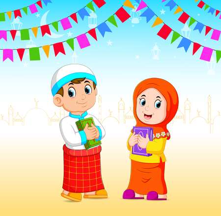 the boy and the girl is holding the al quran in the ramadan event Stock Photo - 120724494