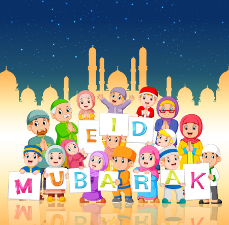 the children are holding the ied mubarak board in the night of ramadan Stock Photo - 120724508
