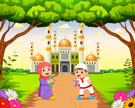 the children are walking and playing near the beautiful mosque Stock Photo