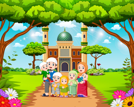 the happy family are posing in front of the beautiful mosque Stock Photo