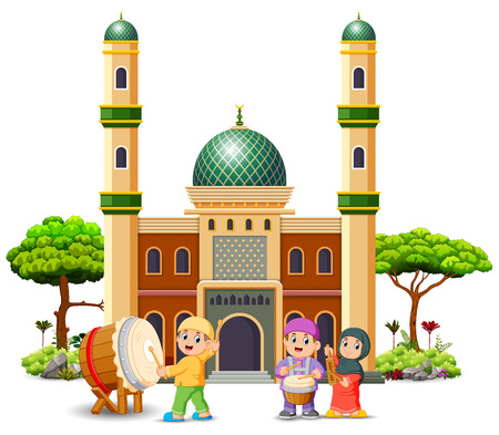 the children are playing with their music tool in front of the mosque Stock Photo