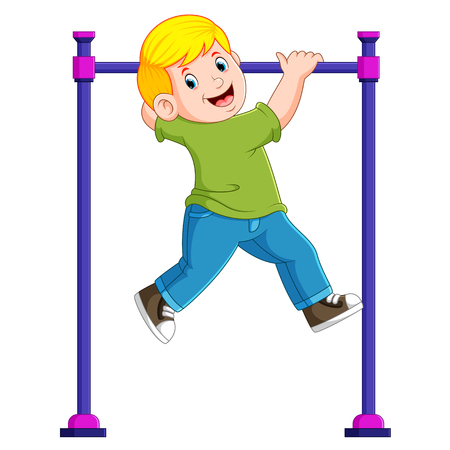 the boy is hanging on the monkey bar