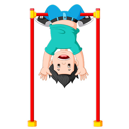 the boy is hanging on the monkey bar with the head on the bottom