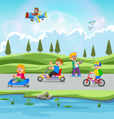the children are playing and riding the bicycle with the beautiful view