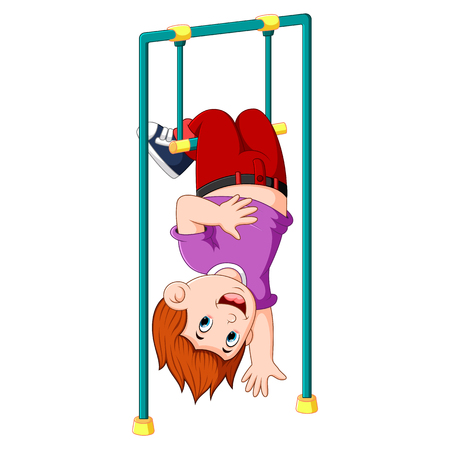 the boy is hanging on the monkey bar with is legs on the top Banco de Imagens