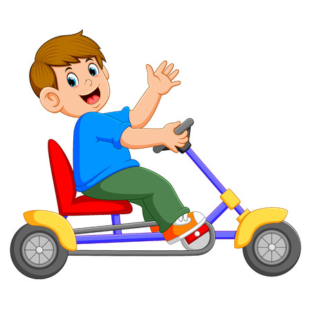 the boy is sitting and riding on the tricycle Stock Photo