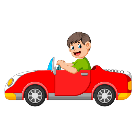 the boy is driving the red car with the good posing Stock Photo
