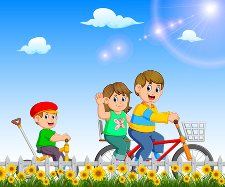 the children are playing and riding the bicycle together in the garden Stockfoto - 122856202