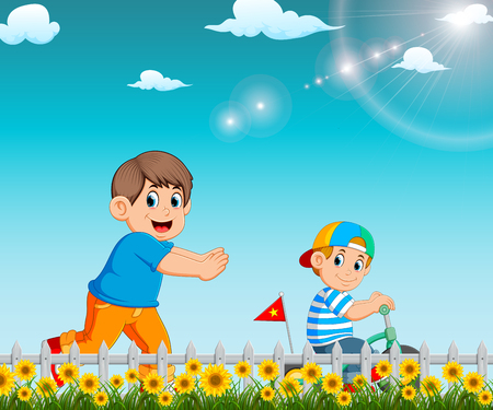 the boy is running to his brother who riding the bicycle in the garden