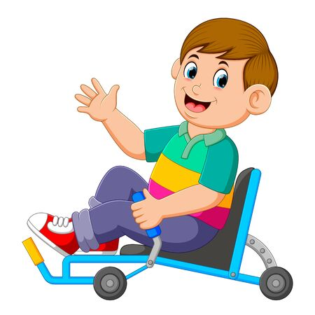the boy is sitting on the recumbent tricycle and holding the controller