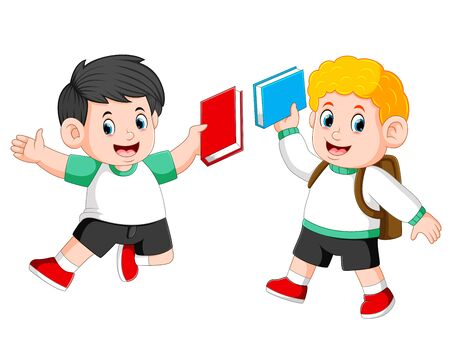 the children are holding their book and jumping together Stock Photo