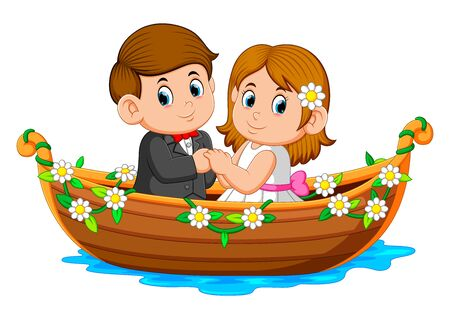 the couple are posing on the beautiful boat with the flowers around it Stockfoto