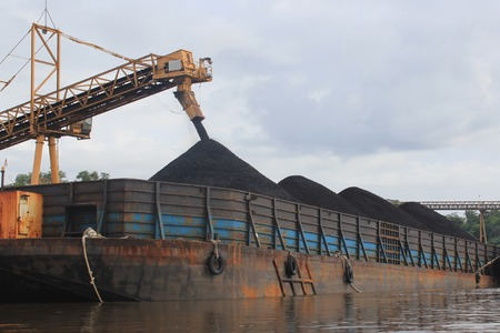 mining ship: Coal barge loading process on the mahakam river