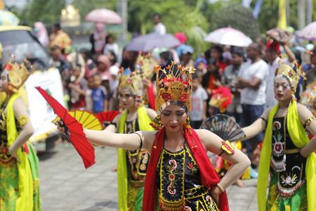 Tenggarong, July 2017 fan dance of java girl dancer participed street performance in erau International folk art festival in tenggarong.