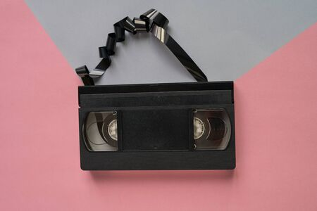 Top of view A videotape unraveled on a pink and grey background.Minimalistic retro concept Stok Fotoğraf