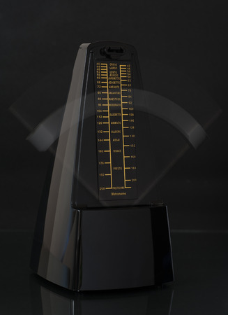 Close up of a ticking metronome photo
