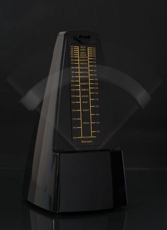 metronome: Close up of a ticking metronome