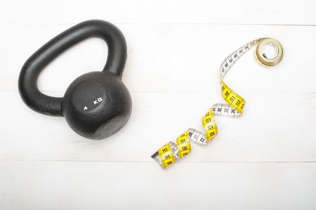 Single kettlebell and tape measure photo