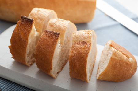 turkish bread: Close up of sliced Turkish Bread on white wooden cutting board Stock Photo
