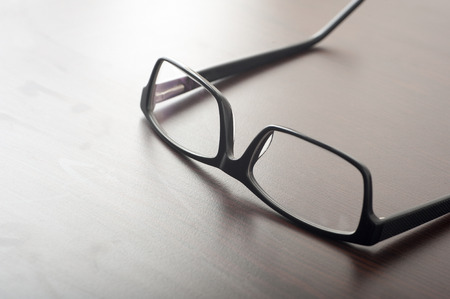 Close up of reading glasses on coffee table