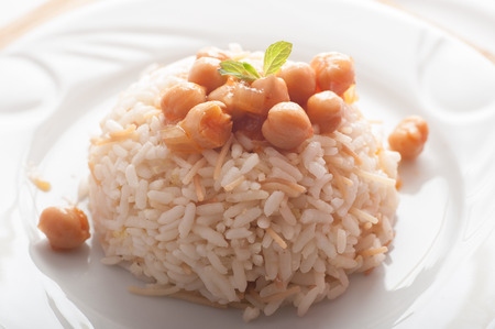Close up of a plate of rice and chick peas