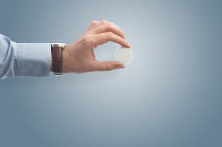 Businessman giving a pill, can be used to stress innovation, idea, problem solving and solution. Stok Fotoğraf
