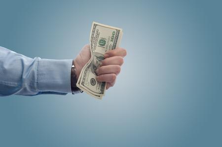Eine Handvoll Dollar mit Kopie Raum Businessmangiving weg Standard-Bild - 43355044
