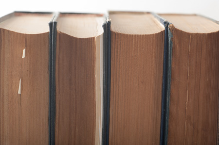Close up of a group of old books piled together Stok Fotoğraf