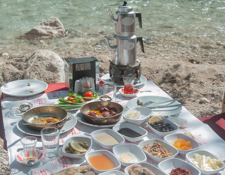 river side: Traditional Turkish breakfast by the river side Stock Photo
